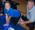 Ali Sammon practices CPR with instructor, Fire Lt. John Sammon (who just happens to be her father). photo by Maddie Gear
