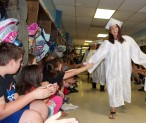 Kendelyn Burton greets Esten Elementary School children on the second annual Rockland High School Senior Walk through the schools prior to graduation on Friday, June 2.