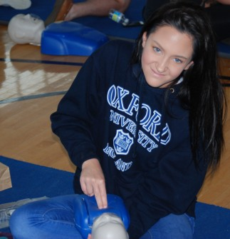 Isabella Sacco practices infant CPR during their CPR certification classes on Thursday and Friday's senior issues program. photo by Maddie Gear