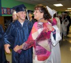 Brian McCullough is greeted by his former teacher, Julie McDonnell at Esten Elementary School on Wednesday, May 31. This is the second year that seniors have walked through the halls of their former elementary school in their caps and gowns prior to graduation.