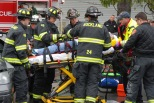 Rockland fire personnel place Mike Belmonte on a stretcher