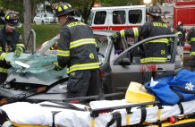 Rockland Firemen work to free Mike Belmonte who is pinned inside the car.
