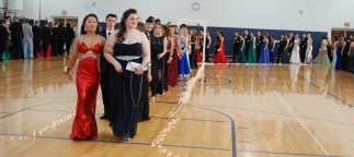 the line of prom goers progresses through the arch