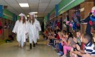 Hannah Millen (left) and Bridget Reardon lead the procession of seniors as they walk through the Esten Elementary School on Wednesday, May 31.