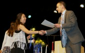 Luana Lima receives her certificate from Mr. Harrison