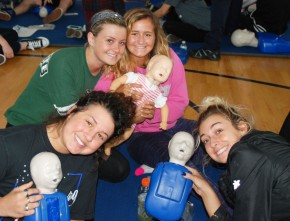 Talia Rindone, Lexi Murphy, Lyndsay Norris, and Brianna LaPaglia with their babies for CPR practice. photo by Maddie Gear