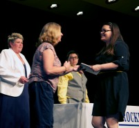 Brenda Folsom presents the Health Department academic award at the senior awards night to Rachel Buker. Veritas photo