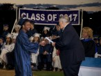 Darcy Guimaraes receives his diploma. photo by Austin Wood