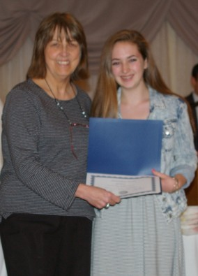 Madeline Lannin-Cotton presents a Journalism Award to freshman, Erin Kearns