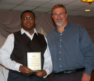 Kevin Jean-Poix received a Social Science/History award from Mr. Grimmett