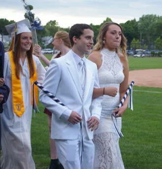 Junior Class Marshalls, Matt O'Brien and Hannah Boben lead the way for the graduating class. Veritas photo
