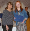 Mrs. Lannin-Cotton presents a Special Achievement Award to the Veritas Website Editor, Sophomore Jasmin Morse