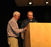 Mike McPeck reads the dedication of the yearbook to Jim Cahill