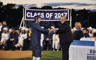 John MacDonald receives his diploma from Richard Phelps while Margie Black looks on. photo by Austin Wood