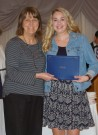 Mrs. Lannin-Cotton presents a Journalism Special Achievement Award to Madeline Gear.