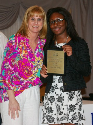 Destinie Irvin receives the Health Department Academic Achievement Award from Mrs. Phelps