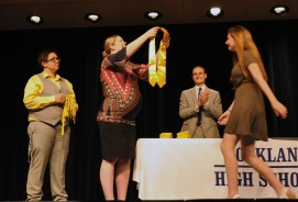 Kendra Donovan presents National Honor Society stole to Nicole Atkins while Sam Hoyo and John Harrison look on.