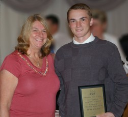 Peter Kohler received the grade 10 academic achievement award in Physical Education from Mrs. Folsom