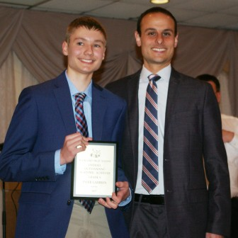 Tyler Gambon received the Overall Academic Achievement Award from Principal Harrison