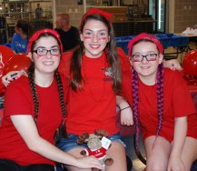 Erin Field, Julia Yeadon and Molly Boggs are decked out in their committee colors at the SGC Camp on Weds. Aug. 9.