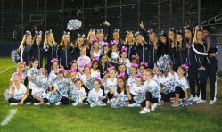 The cheerleaders hosted jr. cheerleaders in the opening night game.