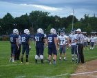 Captains, Connor Shea (11), Jon Baar (12), Lou Casey (51), Will Breadmore (52) meet with Cohasset captains for coin toss