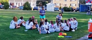 Girls Soccer team at half-time, leading 4-0. photo courtesy Dr. Harrison