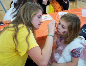 Jaymie Atkins is doing face painting
