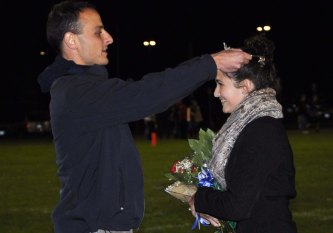 Principal Harrison places the Miss Rockland crown to Macie Jones at last year's Homecoming Game.