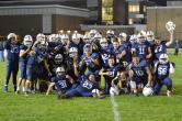 The RHS football team celebrates winning a share of the South Shore League title after their win over Middleboro on Oct. 20. photo courtesy of Kelley Reale