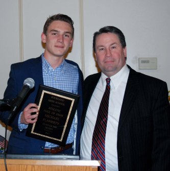Coach Mike Flaherty, Rockland High School Class of 1987, was introduced by his son, Mike at the Hall of Fame banquet. In addition to playing hockey for Rockland, Flaherty is now the team's successful coach. His son, Mike is a senior captain of the team this year.