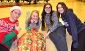 The community service committee posing with their wrapped Chair in the People Wrapping competition.