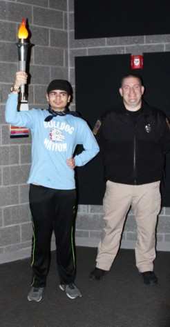 Anthony DiNino and school resource officer, Ethan Schnabel carrying in the Olympic torch