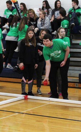 Alex Anzivino rolls a bocce ball as Marissa Smith gives encouragement.