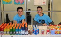 Juniors Justin Sherlock and Francisco Oliveira managing the concessions stand.