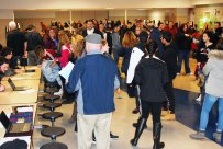 A packed cafeteria filled with eighth graders and their parents learning more about RHS culture.