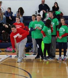 RHS team members watching RHS senior, Harry O'Brien make his throw