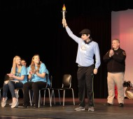 Jamie Atkins and Jill Donahue admiring torch holder, RHS Special Olympian, Anthony DiNino.