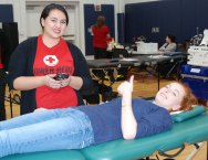 Junior Jasmin Morse is preparing to donate blood with one of the Red Cross workers on Jan. 24 at Rockland High School. Veritas photo