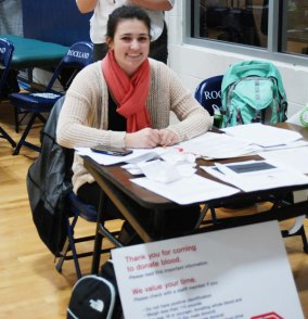 National Honor Society Macie Jones registers blood donors on Jan. 24 in the back gym. photo by Jasmin Morse