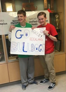 Nick Cara and Madison Parlee holding a sign showing their Rockland support.