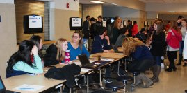 RHS students in the cafeteria at booths to explain the clubs and activities here at RHS.