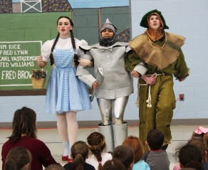 "Emily Gaboriault , Rebekah Panaro and Ryan Struzziery sing ""We're Off to See the Wizard"" at Esten Elementary School"