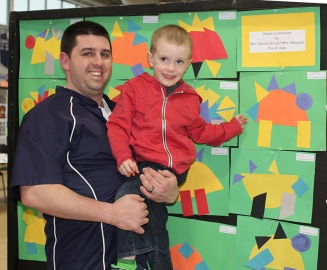 Mr. Mike Doyle and his son Connor whose art work was displayed in the pre-school part of the exhibits. Veritas photo