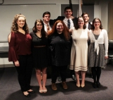 From left: Stephanie Blaney, Brianna Ferraro, Kellie Berry, Saoirse McNally and Erin Field. Back from left: Sean Sugrue, Aiden Glennon and Sean Fitzgerald at the Spellman Oratorical Contest. Veritas photo