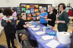 Middle Schoolers work on their projects. There were many Interactive exhibits at this year's arts festival. Veritas photo