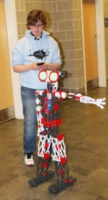 Sophomore Joe Messier and a robot from the Robotics Class at RHS. Veritas photo