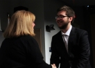Sean Fitzgerald is congratulated by Ms. Cahill after the Spellman Oratorical Contest. Veritas photo