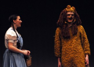 Dorothy encourages the Cowardly Lion