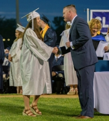 Grace Oliver receives her diploma.